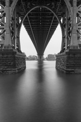 Black an white photo of Williamsburg bridge on a foggy morning with long exposure