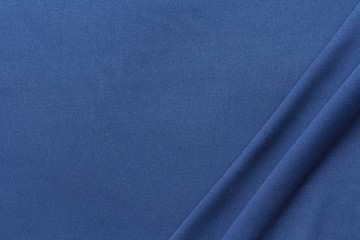 dark blue fabric with two large diagonal folds