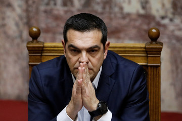 Greek PM Tsipras looks on during a parliamentary session before a confidence vote in Athens