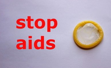Condom as a symbol of protection from AIDS. Concept is a healthy lifestyle