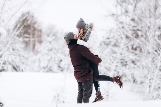 Young couple in love outdoor snowy winter