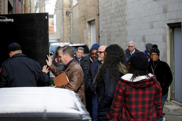 A court-ordered inspection is conducted in a warehouse serving as R. Kelly's recording studio in Chicago