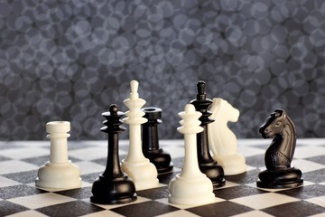 Chess is a popular ancient Board logic antagonistic game with special black and white pieces, on a cell Board for two intelligent opponents.