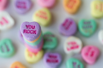 Valentine photograph of multicolored candy hearts with a You Rock standout