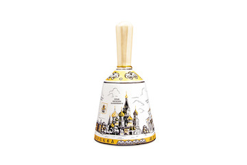 ceramic souvenir toy in the form of bell with beautiful color painting on isolated white background reflecting the national Russian culture with the inscription in Russian: city name Moscow