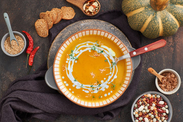 Pumpkin, mixed beans and sweet potato creme soup in ceramic bowl,