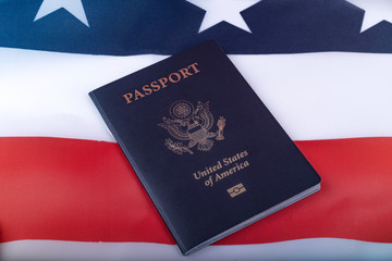 American Passport on Flag of USA surface. Close up view.