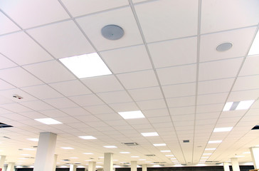 White office ceiling with white tiles and lighting
