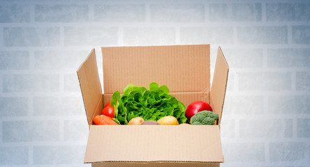 Vegetables box, delivery box. Fresh fruits and vegetables .