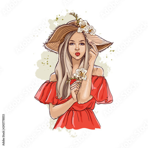 b77f49ca5ab Portrait of fashionable woman in hat with flowers. Beautiful young woman in  summer clothes covers her face with a hat. Stylish girl in a hat.