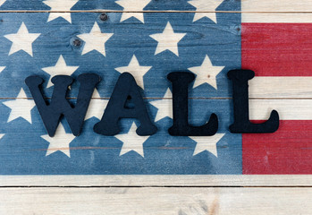 Close up of wall text letters on vintage wooden United States flag with metal letters spelling wall for border concept