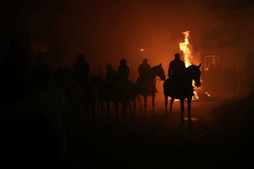 """Riders wait for the start of the annual """"Luminarias"""" celebration northwest of Madrid"""