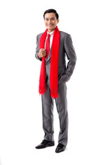 Portrait of cheerful businessman wearing red scarf for Chinese New Year, isolated on white