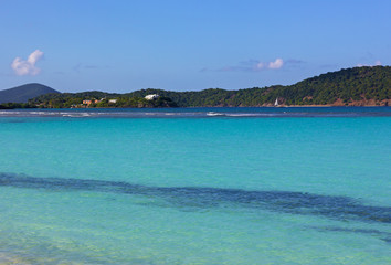 Fototapete - The azure waters of the Caribbean Sea near the island of St. Thomas, USVI. The tropical climate and sandy beaches make the island an ideal place for a winter holiday.