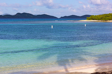 Fototapete - Beautiful sandy beach with spectacular views on other small islands at St. Thomas, USVI. The tropical climate and sandy beaches attract vacationers in winter months.