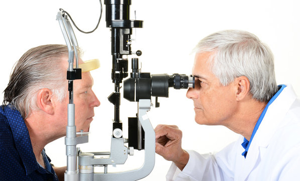 An Ophthalmologist and patient with a Slit Lamp
