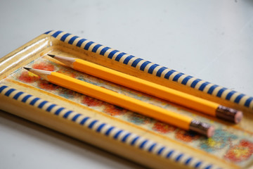 A pencil case and pencil on the desk