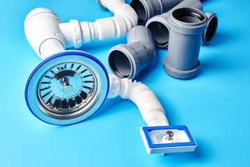 Plumbing sewer pipes on blue background