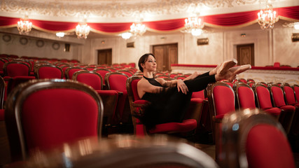 Ballerina Resting In Auditorium after rehearsal