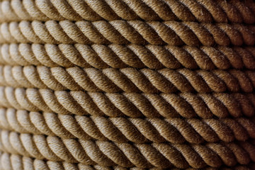 Close up view of brown rope. Textured background