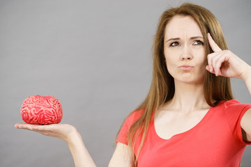 Woman holding brain thinking