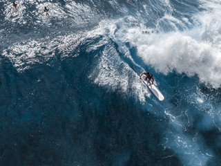 Aerial view of the surfer riding ocean wave. Oahu, Hawaii