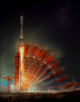 Missile launch at night. Illusion of multiple rocker arms. The elements of this image furnished by NASA.