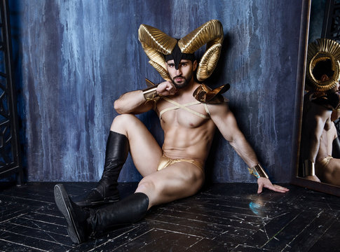 man  wearing a stage costume with big golden horns