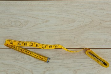 Measuring tape on a wooden table