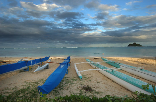 Outrigger canoes are parked on Lanikai beach in Kailua, Hawaii.