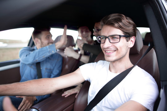 Close up side portrait of happy man driving car