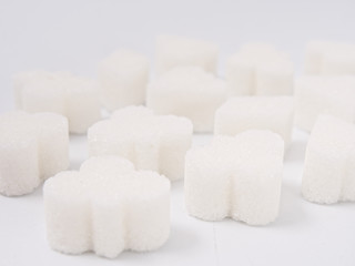 white lump sugar refined on a white background.