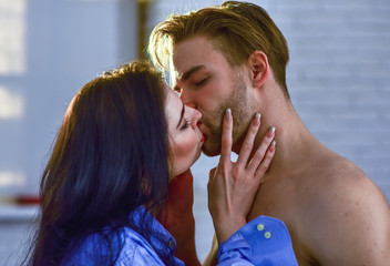 Passionate kiss concept. Couple in love kissing with passion. Man and woman attractive lovers romantic kiss. Seduction and foreplay. Sensual kiss of lovely couple close up. Celebrate valentines day