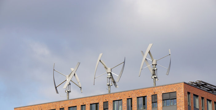wind power generator turbines on an urban building roof