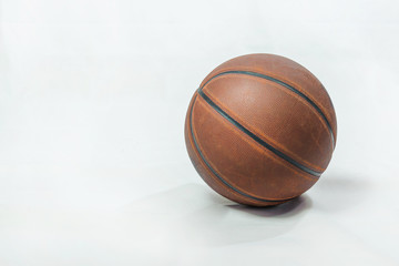 Old brown basketball ball on white background