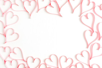 Wreath frame mock up made of paper heart symbols on white background. Flat lay, top view Valentines Day background love concept.