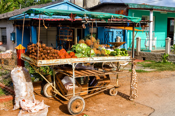 Fruit and vegetables for sale on an old, basic trolley acting as a market stall outside a building in Vinales, Cuba. Private enterprise is new to Cuba.