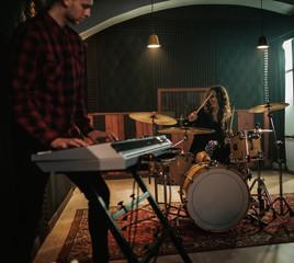 Music band having rehearsal in a studio