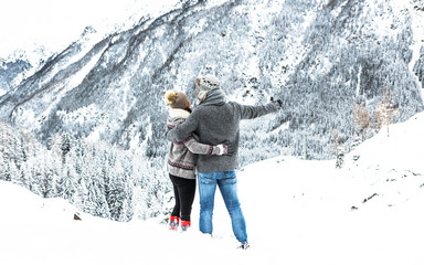 Loving couple looks together at the mountain