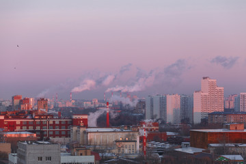 Moscow, Russia. Environmental problem, the smoke from the pipes flies towards residential areas and houses