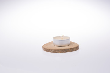 Candle placed  on a white background