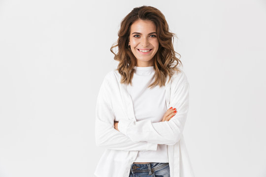 Portrait of smiling woman 30s in casual clothes standing, isolated over white background