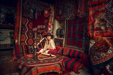 Girl in old carpet shop in Cappadocia