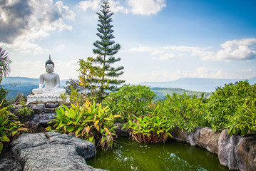 buddha statue white on the rock hill