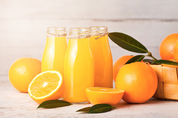 Glass bottles of raw organic fresh orange juice