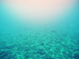 Photo of sea under water, blue lagoon, light of sun from surface