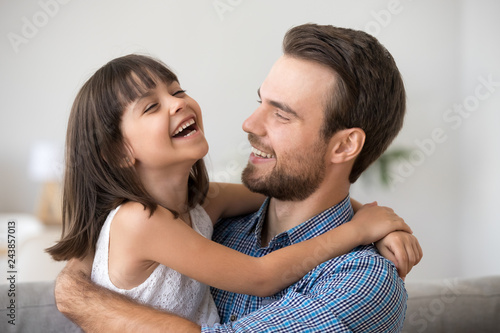4ddd8e4f5 Happy dad holding cute cheerful kid daughter laughing enjoy good time  together, loving father and smiling little girl hugging, caring daddy  embracing funny ...