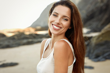 Beautiful smiling woman spends time on the beach
