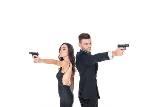 couple of secret agents in black clothes aiming with weapon, isolated on white