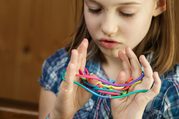 Girl playing classic string game, creating shapes